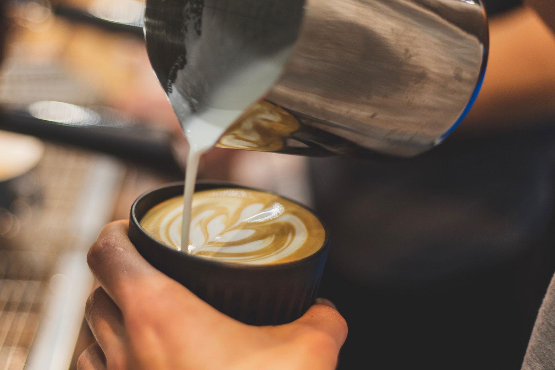 Barista Pouring a Latte